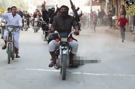 Pictures: ISIS mob drag three Syrian soldier corpses through streets