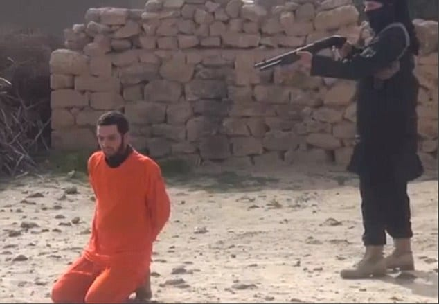 ISIS execute Syrian prisoner shotgun