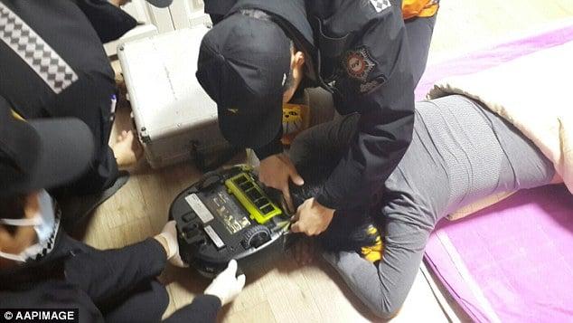 South Korean woman robot vacuum cleaner