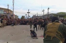 Pictures: ISIS stones to death couple accused of fornication before marriage.