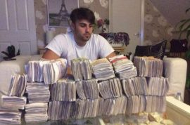Olsi Beheluli, idiot drug dealer poses with stash of cash jailed.