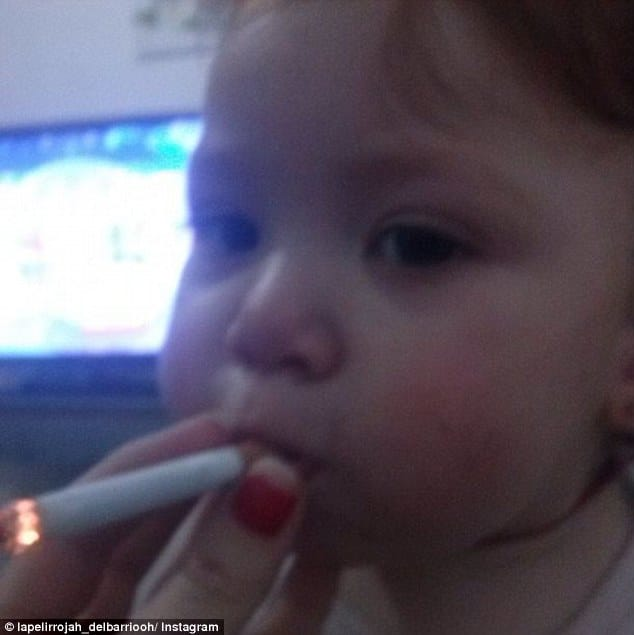 Spanish woman posts picture of baby smoking cigarette