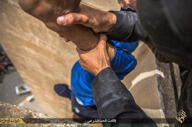Photos: ISIS dangle gay man by his ankles before dropping him 100ft