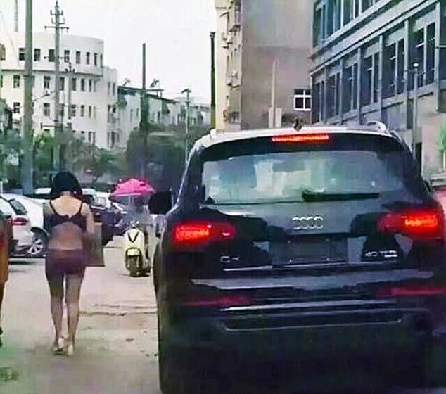 Chinese husband forces cheating wife to walk in underwear