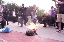 Were Disarm the Police protesters wrong in setting fire to flag?
