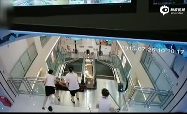 Chinese mother swallowed by escalator