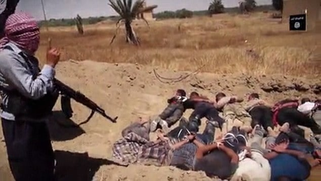 ISIS execution video shows prisoners in mass graves machine gunned to death