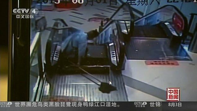 Shanghai shopping mall cleaner leg ripped off escalator