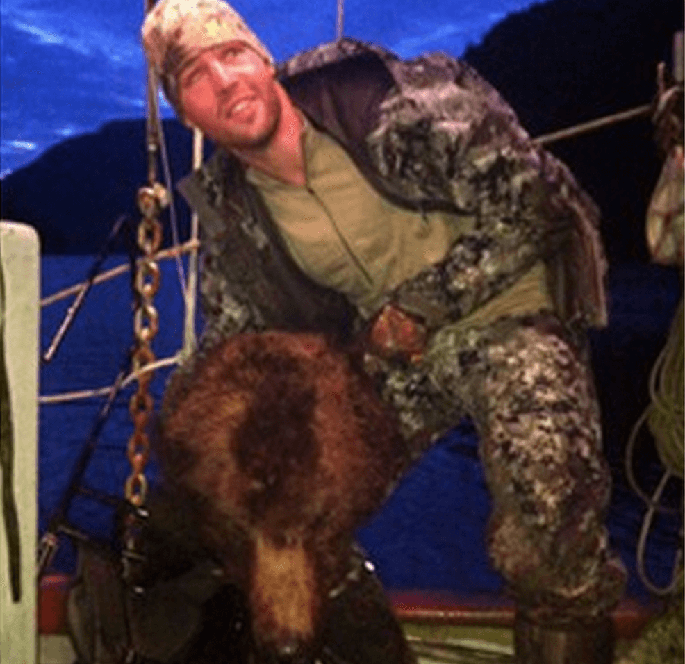 Clayton Stoner, NHL player posing dead bear's head