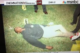 Why did George Zimmerman tweet photo of Trayvon Martin's body?