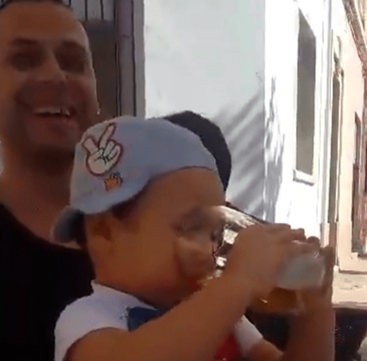 Romanian toddler forced to smoke and drink alcohol