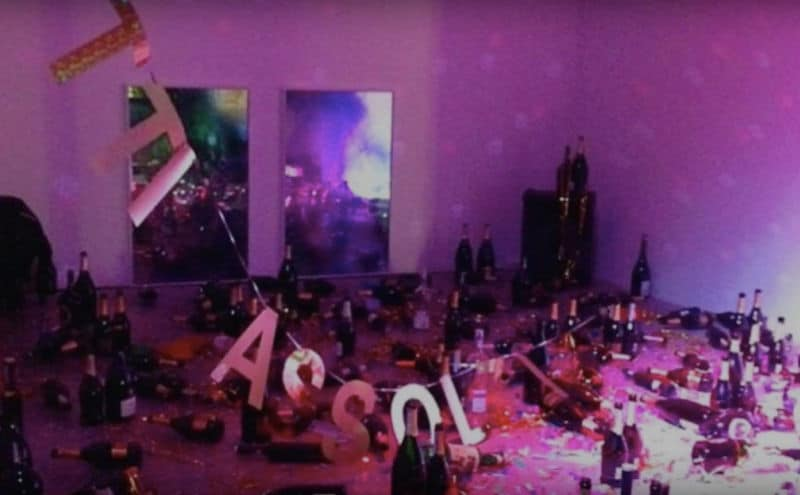 Italian art installation of empty champagne bottles thrown away