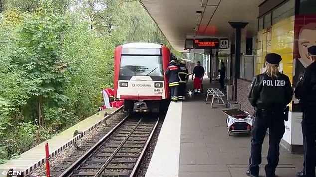 German boy's legs crushed after mom pushes him under train