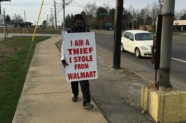 Right choice? Greg Davenport chooses to wear 'I am thief' sign instead of jail