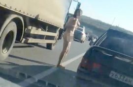 Video: Naked Russian woman walks down Moscow motorway and no one cares