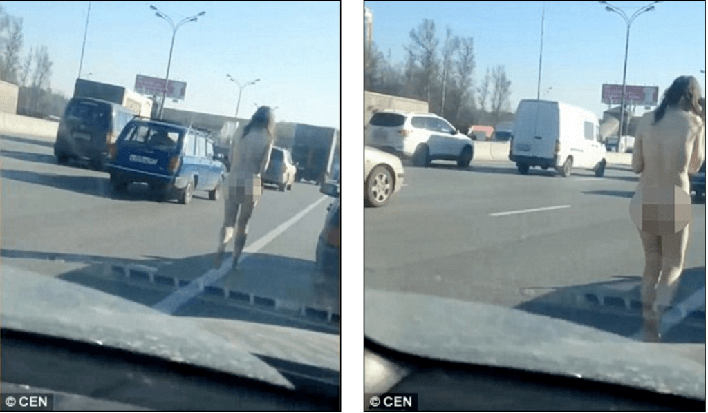 Naked Russian woman walks down Moscow motorway