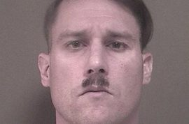 Bruce J. Post III: White supremacist Hitler look alike found with combat gear and firearms cache
