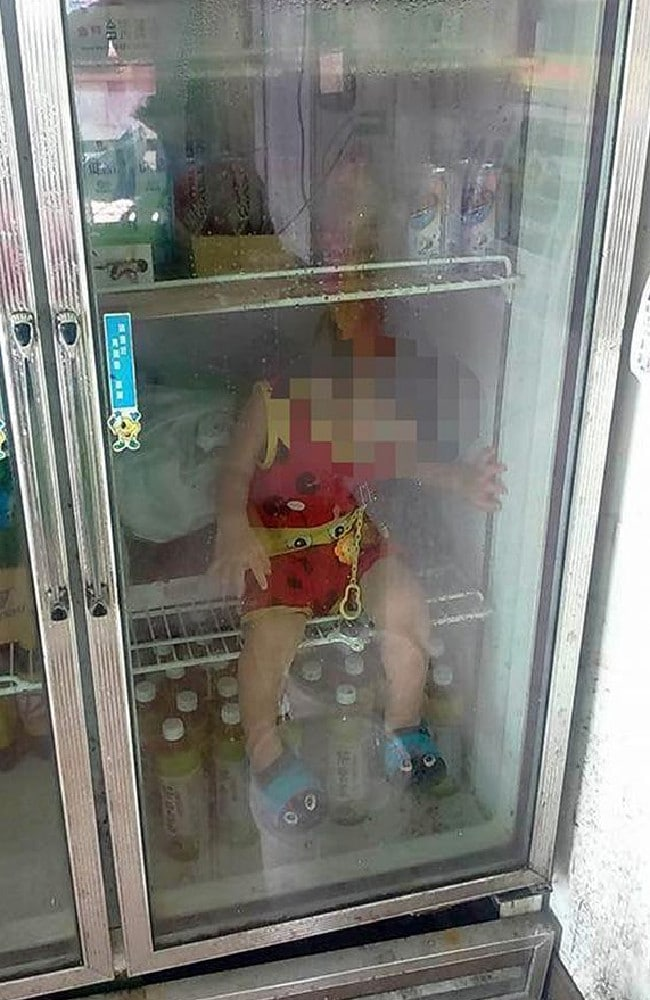 taiwan dad child abuse son sitting inside fridge