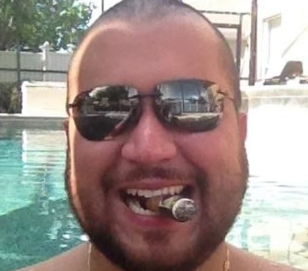 George Zimmerman punched face bragging diner