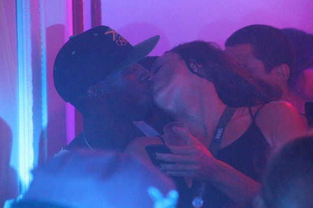 Usain Bolt kissing