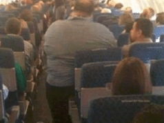 passenger sues American Airlines after sitting next to two obese passengers 14 hours