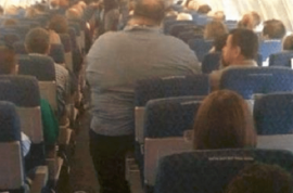 Michael Anthony Taylor sues American Airlines for $100k after sitting next to two obese passengers for 14 hours