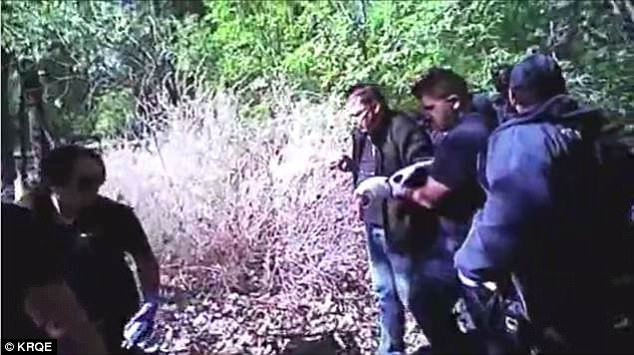 Video shows police rescue man nailed to tree