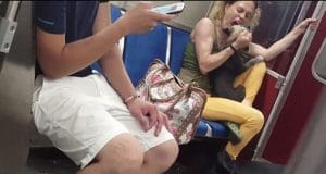 Toronto subway woman biting her dog