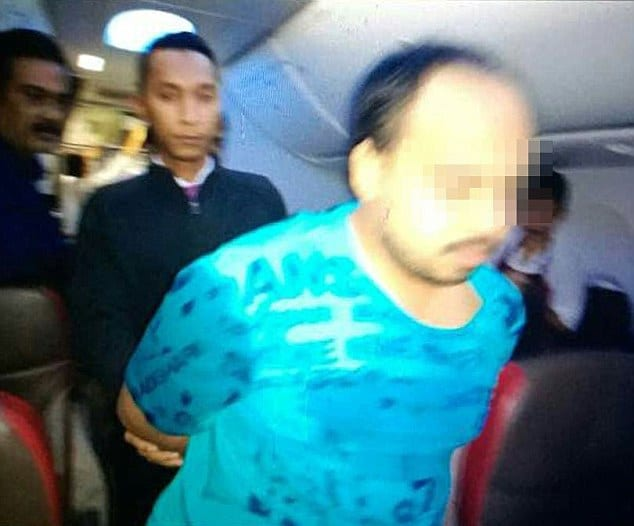 Malindo Airlines passenger strips during flight