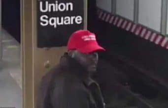 Black man wearing Make America Great Again hat