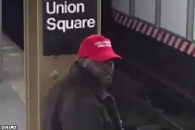 Black man wearing Make America Great Again hat