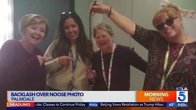 Palmdale teachers pose smiling with noose