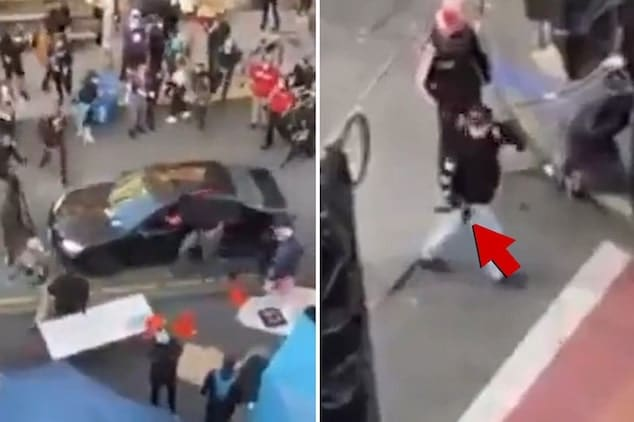 Man drives car through Seattle protesters