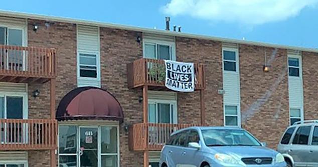 BLM flag Bloomington apartment eviction